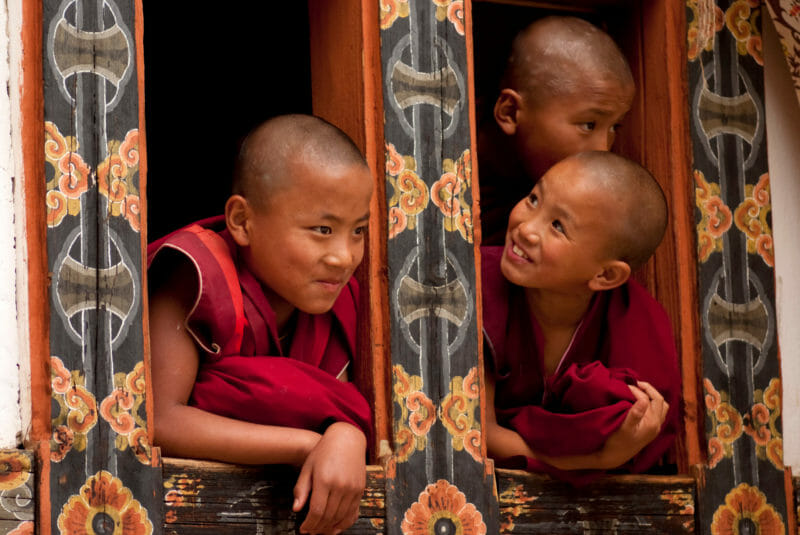 Three young Buddhist monks
